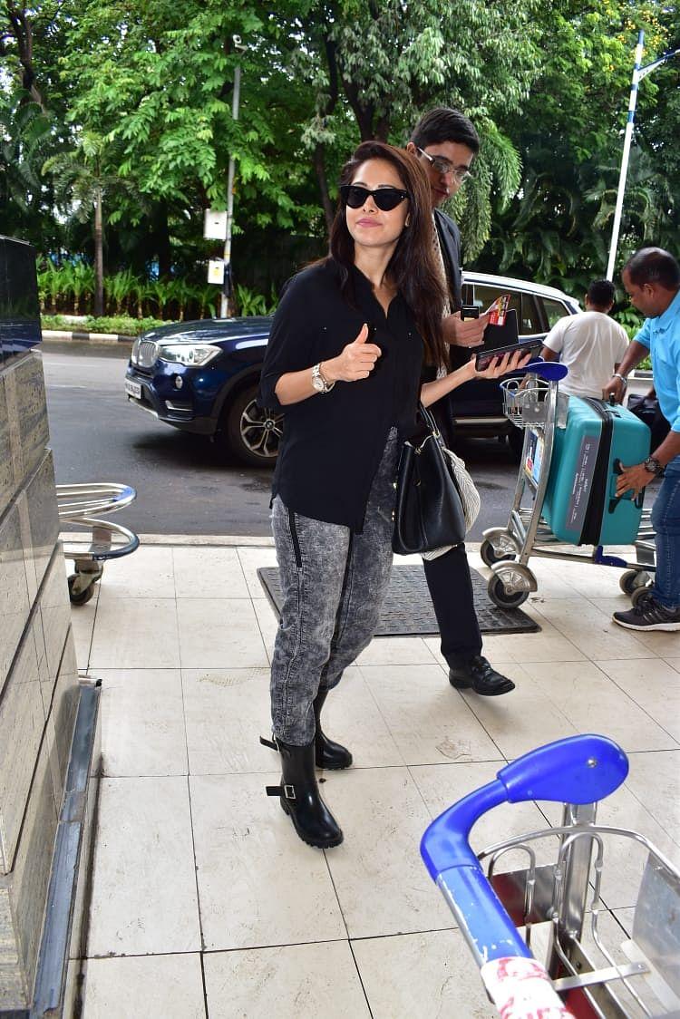 Nushrat Bharucha posed to camera at Mumbai airport.
