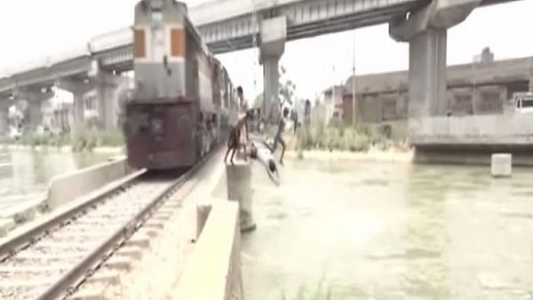 Boys perform dangerous stunts, jump into canal from railway tracks in Ludhiana