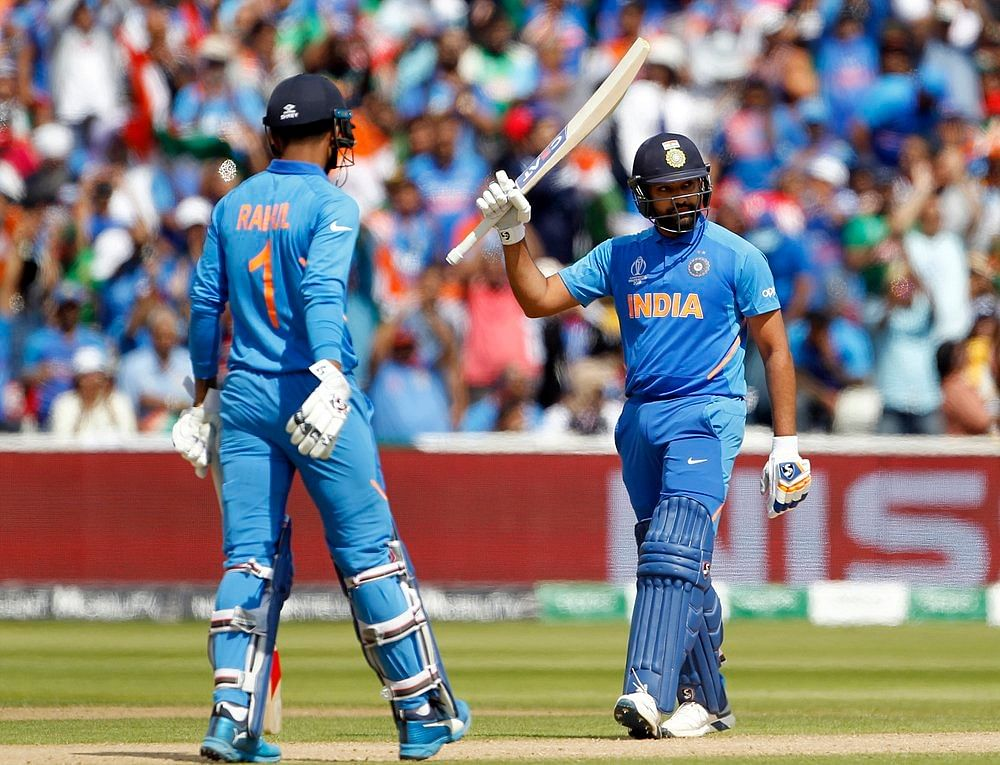 Indian batsman Rohit Sharma celebrates his half-century during a match against Bangladesh in ICC CWC 2019 at Edgbaston in Birmingham on Tuesday