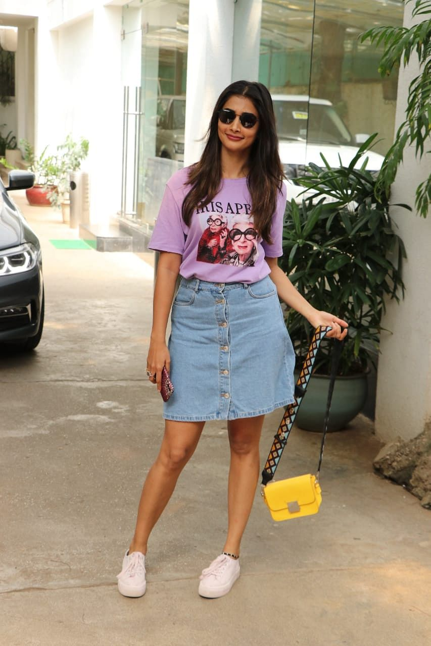 Actor Pooja Hegde spotted at sunny super sound in Juhu, she was sporting a jeans skirt with a casual pink t-shirt and classic white sneakers.
