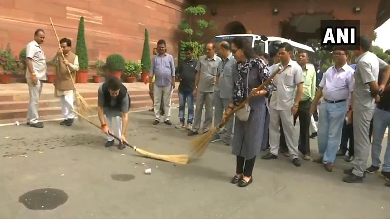 Watch: BJP MPs Anurag Thakur, Hema Malini sweep Parliament premises under Swachh Bharat Abhiyan
