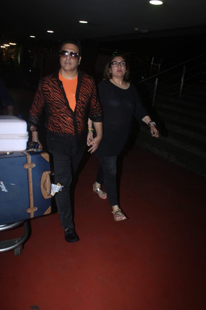 Actor Govinda in his iconic style outfit, Orange tshirt under black striped sher shirt