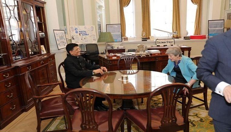 Piyush Goyal meets Theresa May in London