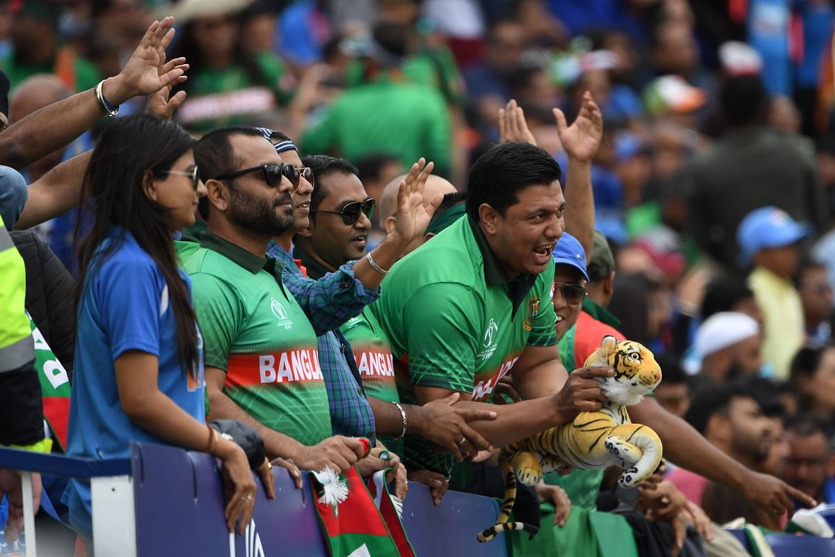 Bangladesh fans cheer during the 2019 Cricket World Cup group stage match between Bangladesh and India at Edgbaston in Birmingham, central England, on July 2, 2019