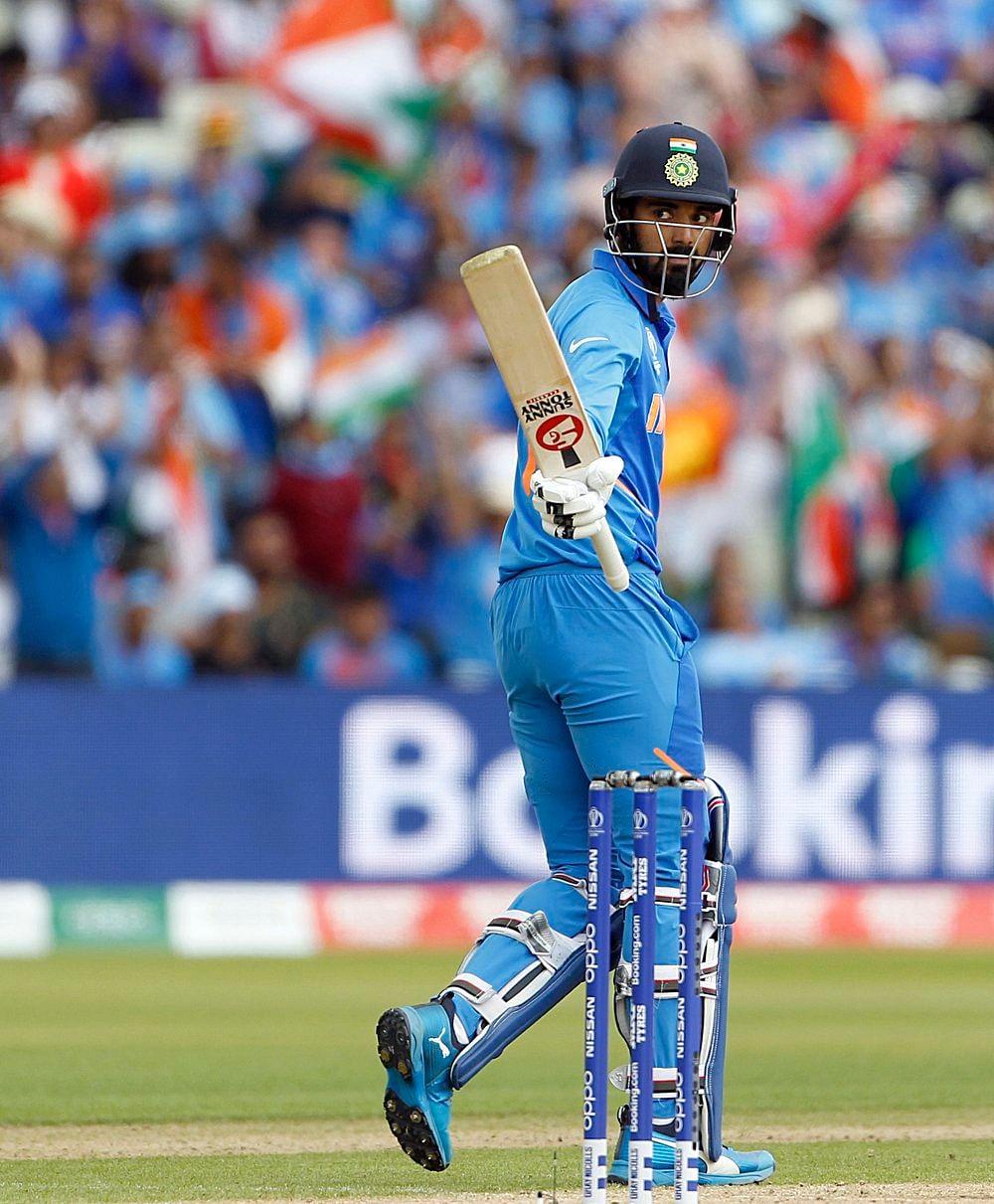 Indian batsman Lokesh Rahul celebrates his half-century during a match against Bangladesh in ICC CWC 2019 at Edgbaston in Birmingham on Tuesday