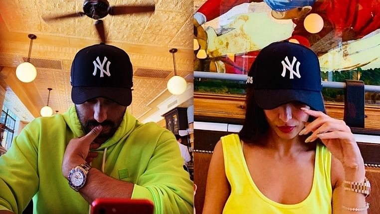 Arjun Kapoor, Malaika Arora twin in neon and Yankees cap during their lunch date
