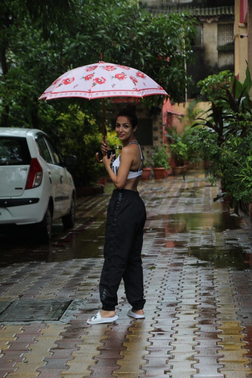 Malaika Arora Khan after returning from Delhi headed out for gym session on a rainy saturday