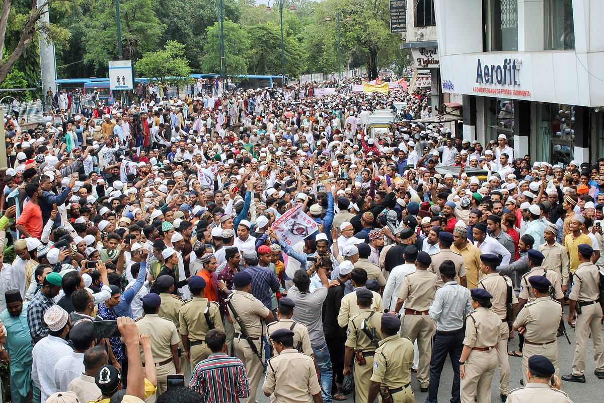 Protesters clash with police at a rally against incidents of mob lynching, in Surat.