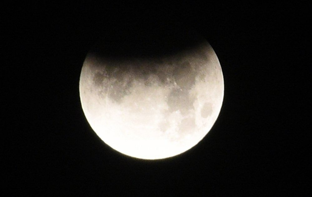 Partial Lunar Eclipse, as seen in the skies of Surat on Tuesday