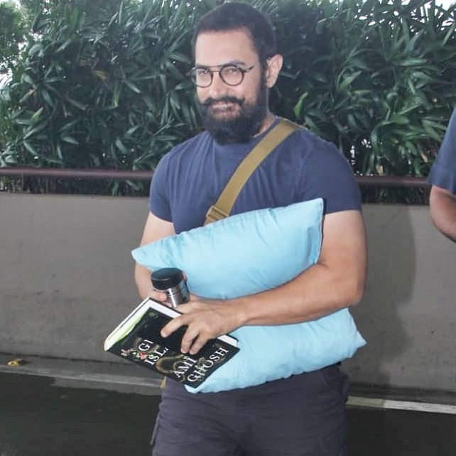 Aamir Khan carries his own pillow and book for a flight; find out what he's reading
