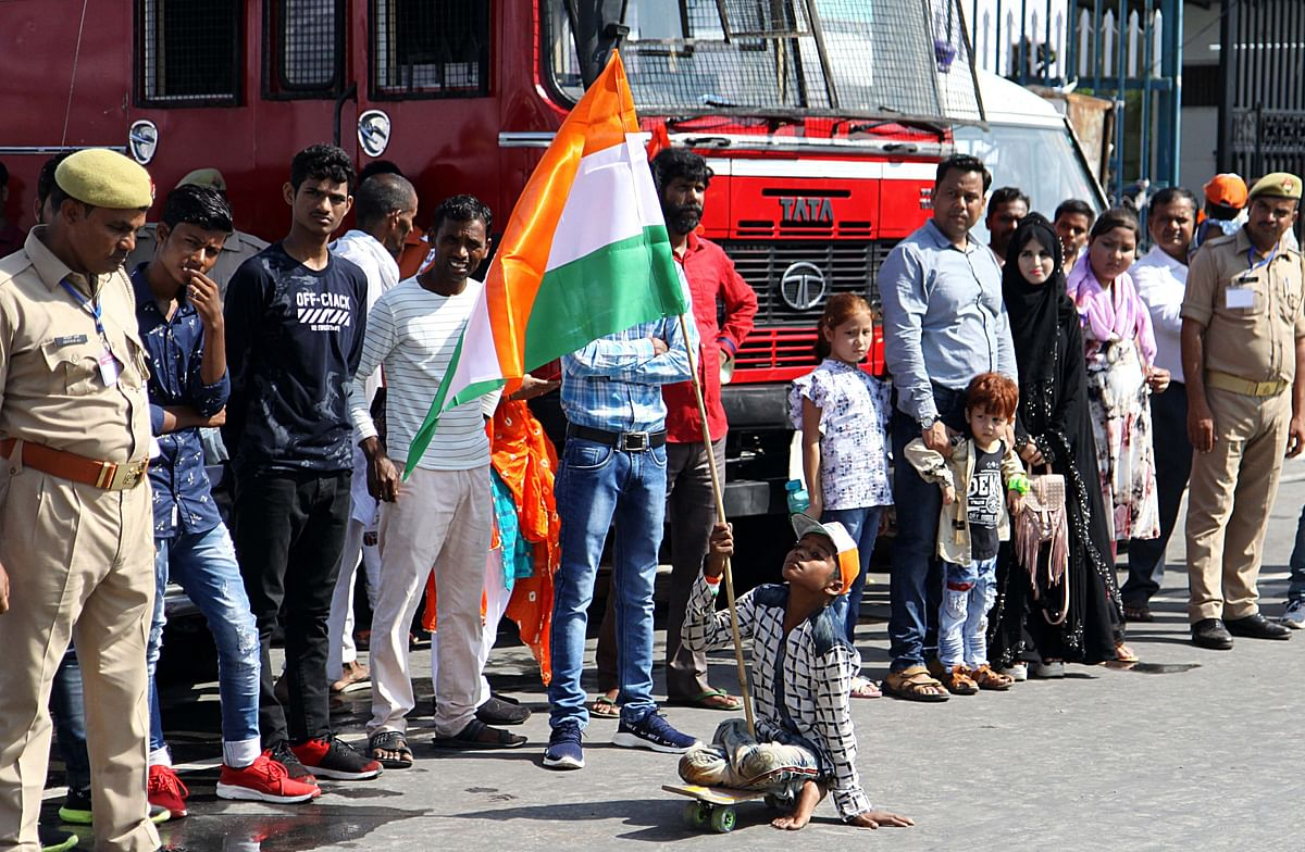 A disabled boy holding tricolor and moving on wheeled to express his joy in front of Vidhan Bhawan during Independence Day celebration in Lucknow
