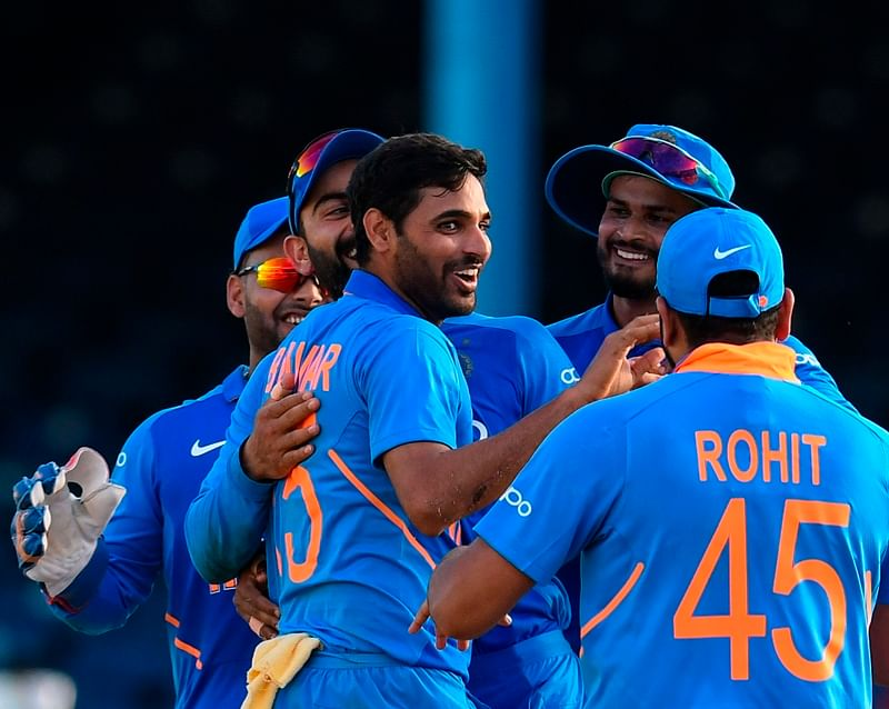 Bhuvneshwar Kumar (C) of India celebrates the dismissal of Roston Chase (not pictured) of West Indies during the 2nd ODI match between West Indies and India at Queens Park Oval in Port of Spain, Trinidad and Tobago,