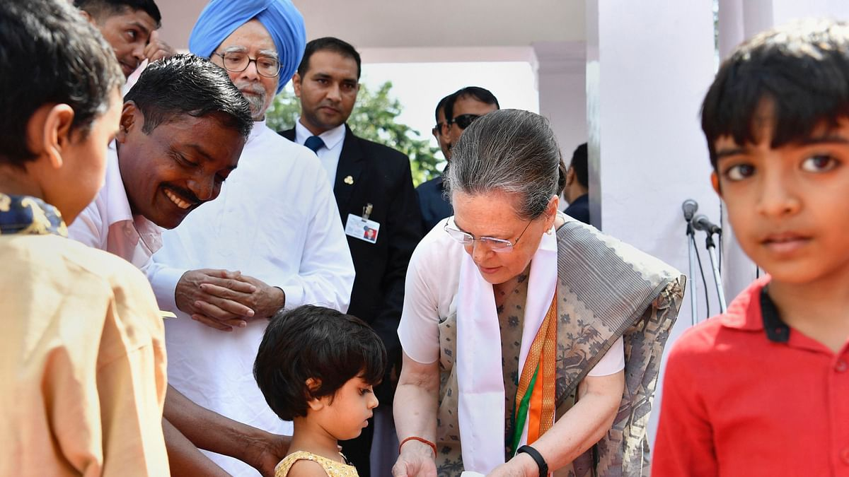 Congress party's interim president Sonia Gandhi offers sweets to a girl during 73rd Independence Day celebrations at AICC office, in New Delhi, Thursday, Aug 15, 2019