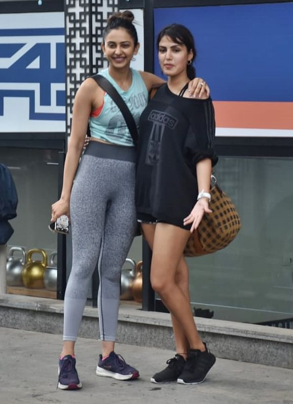 Rakul Preet, Rhea Chakraboty were snapped together post a gym in Juhu. Rakhul was seen in a grey legging and blue tank top, Rhea donned a black t-shirt that hid her jeans shorts.