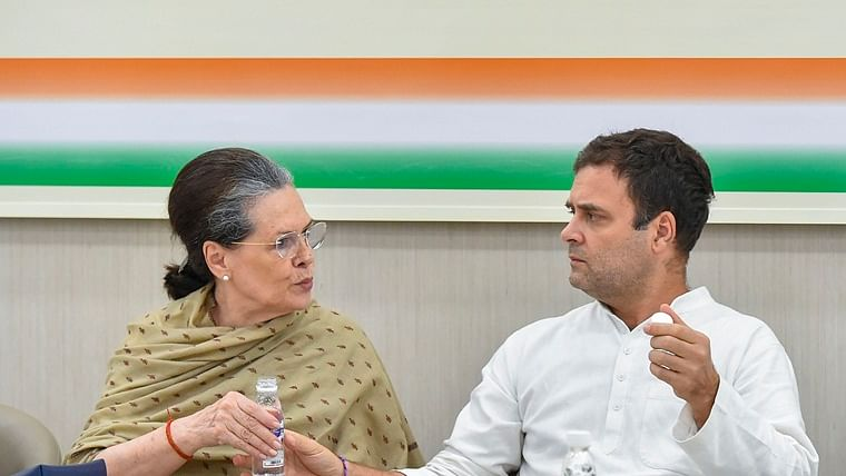 Congress interim president Sonia Gandhi with Rahul Gandhi.