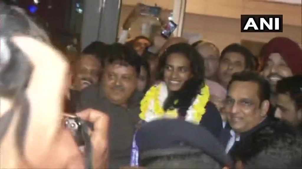 PV Sindhu welcomed at IGI Airport on her return from Switzerland after winning the BWF World Championships, the first-ever Indian shuttler to achieve the feat