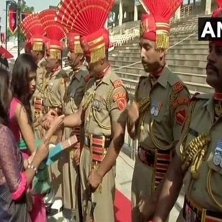 """Punjab: Women tie """"rakhis"""" to BSF jawans at Attari-Wagah Border"""