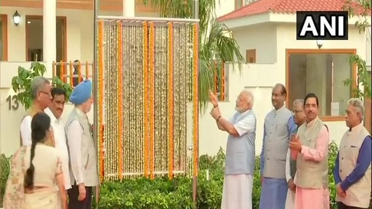 PM Narendra Modi inaugurates newly constructed 36 swanky duplex flats for MPs