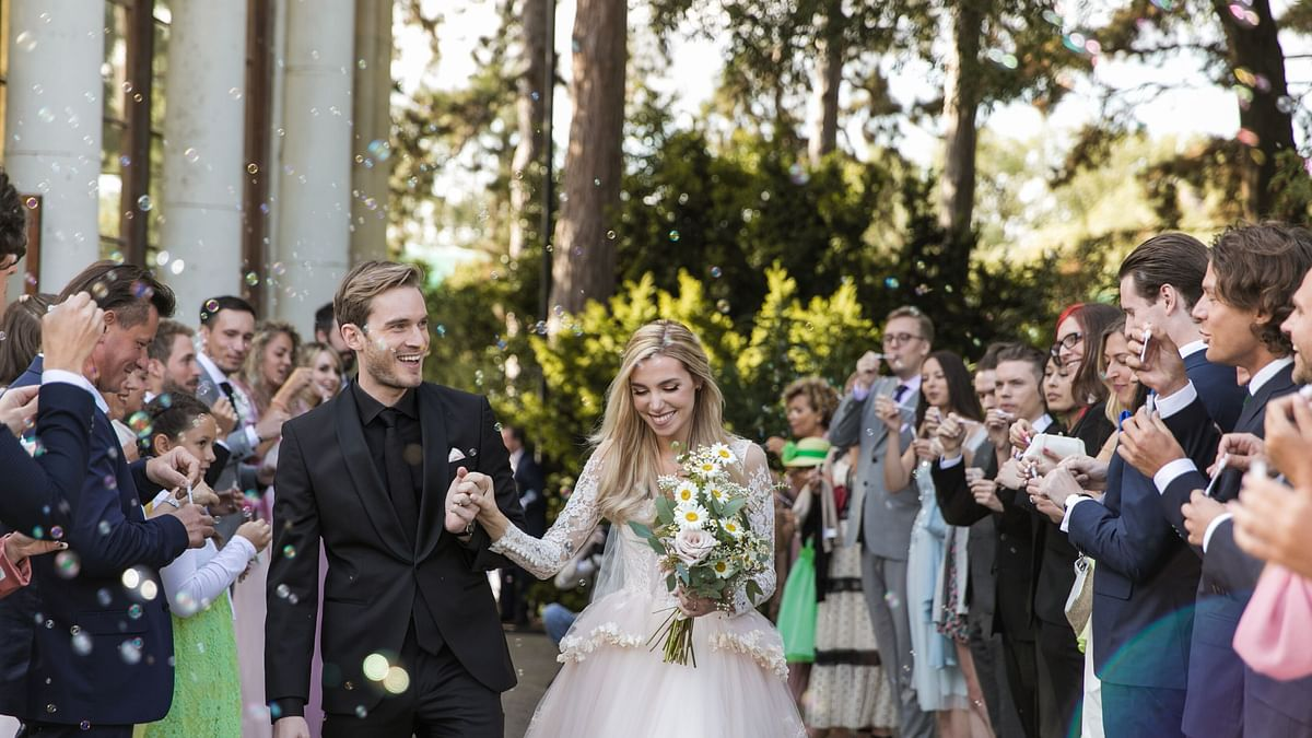 PewDiePie and Marzia Bisognin at Kew Gardens, London, on their wedding day.