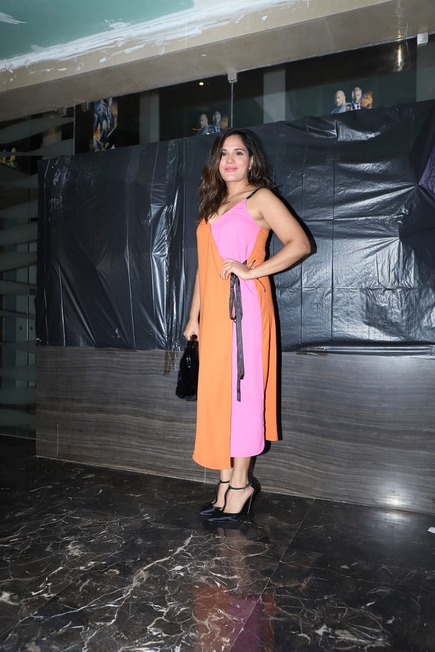 Richa Chadda was seen in a funky pink and organe dress pairing it with classic black heels.