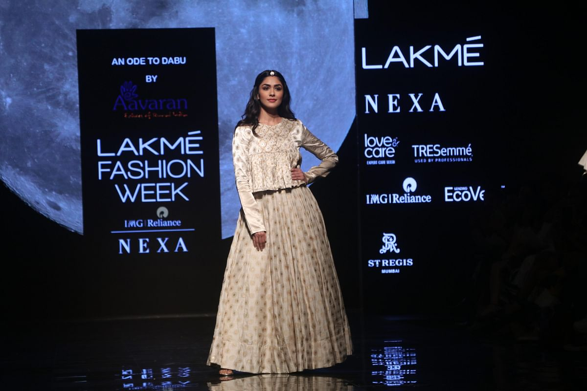 Mrunal wore a mulberry silk, ivory, gold lehenga with ornate embroidery, teamed by a bandhgala, full sleeve top.