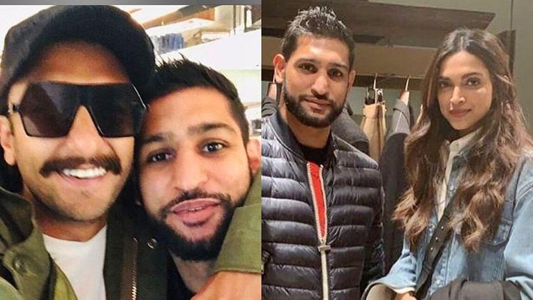 British boxer Amir Khan strikes a pose with Deepika Padukone, Ranveer Singh