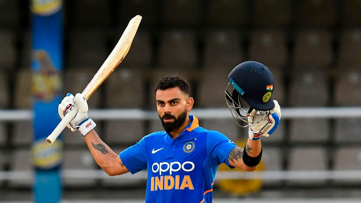 Virat Kohli of India celebrates his century during the 3rd ODI match between West Indies and India at Queens Park Oval, Port of Spain, Trinidad and Tobago