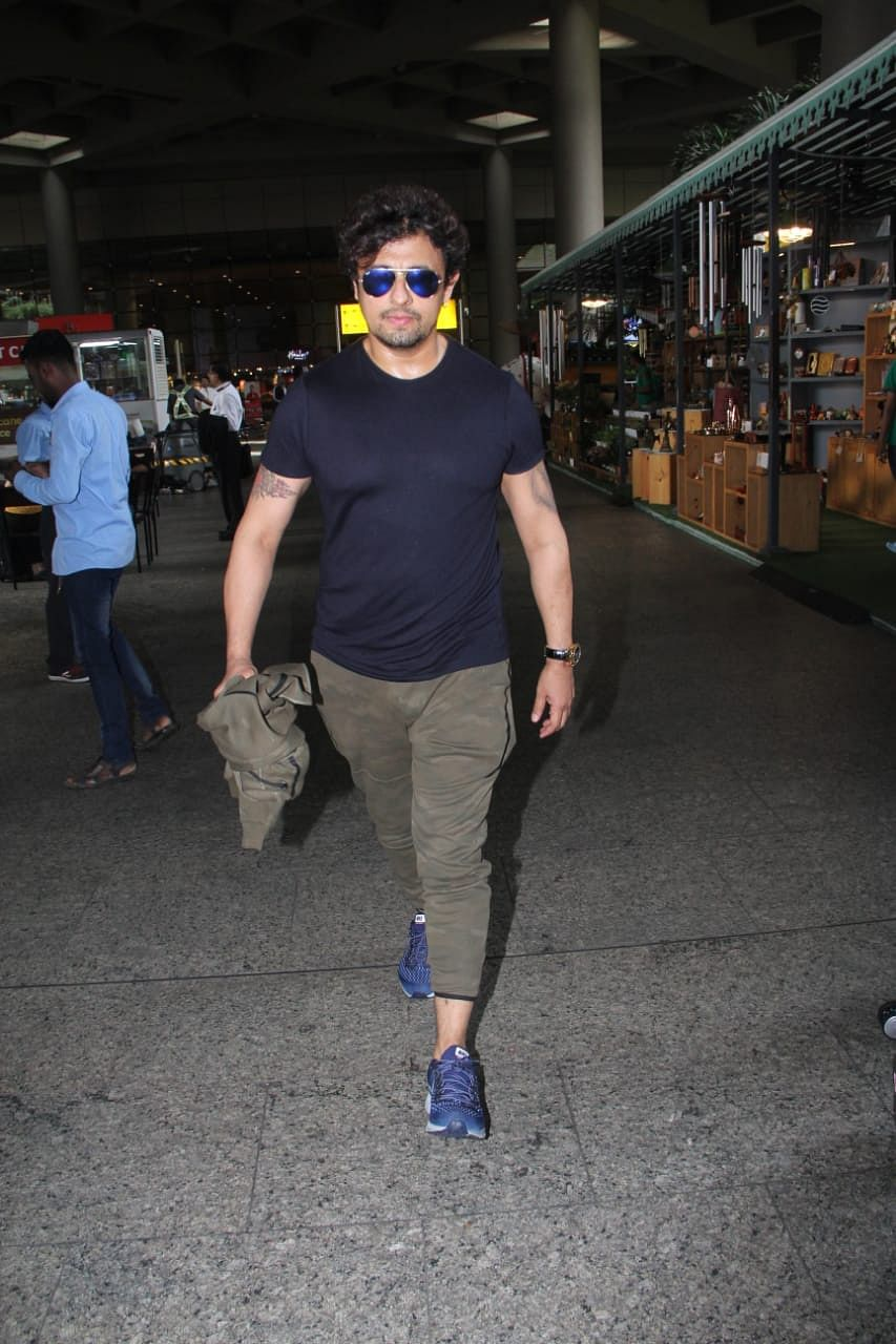 Singer Sonu Nigham was snapped in all black as he headed home after boarding a flight from London.
