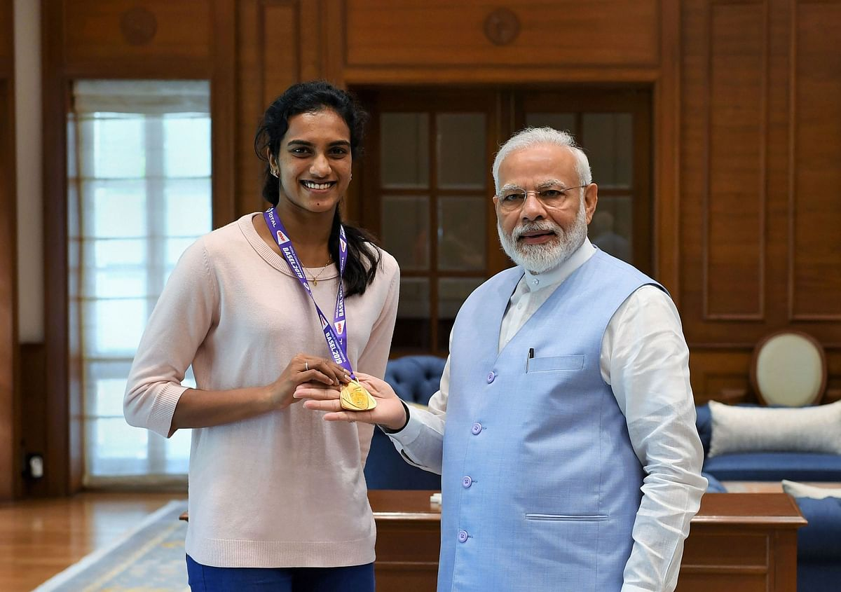 Prime Minister Narendra Modi meets World Champion PV Sindhu, in New Delhi. Sindhu became the first Indian to win the badminton World Championships by beating familiar rival Nozomi Okuhara of Japan in a lop-sided final in Basel