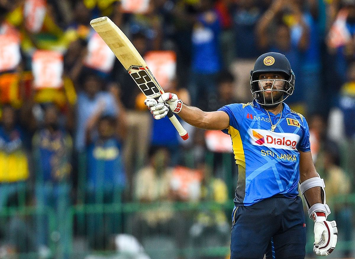 Kusal Mendis escapes unhurt after falling off the bike while celebrating win over Bangladesh