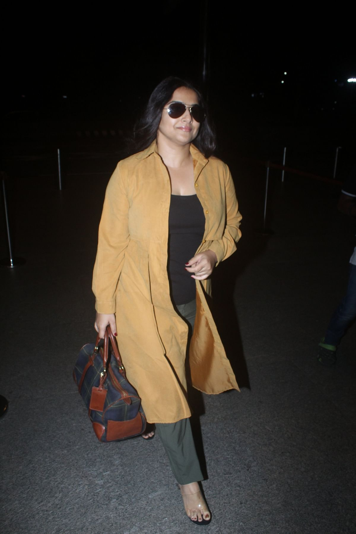 Vidya Balan was spotted at the airport in a casual attire that stood out with her mustard long jacket.