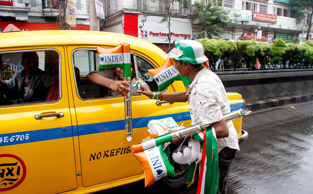 A man sells National flags on the occasion of 73rd Independence Day in Kolkata