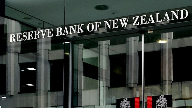 New Zealand's central bank cuts its benchmark policy rate to all-time low, stuns markets with 50-bp rate cut