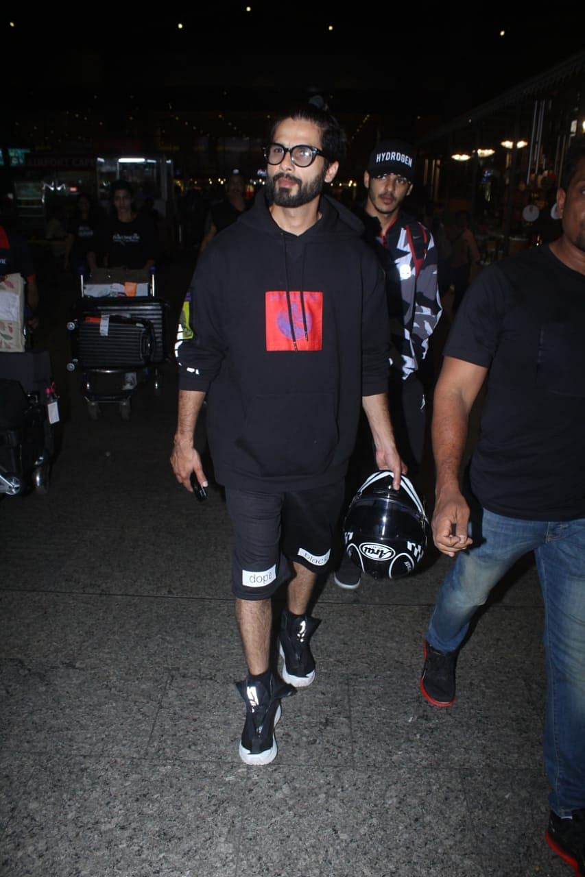 Shahid was snapped at Mumbai airport with Ishaan both holding on to their helmets as they headed for their cars.