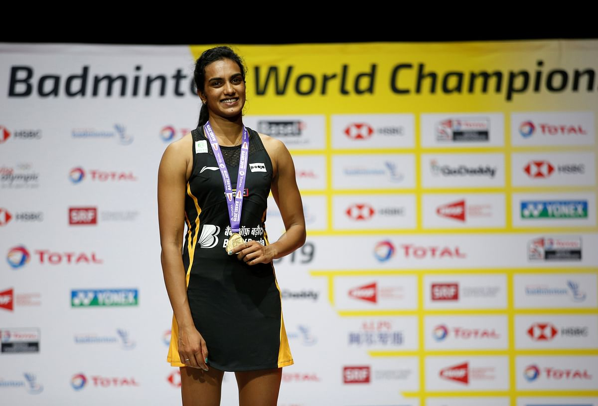 India's Pusarla Sindhu celebrates on the podium with her gold medal after winning the women's singles final 2019 -Badminton World Championships at St. Jakobshalle Basel in Basel