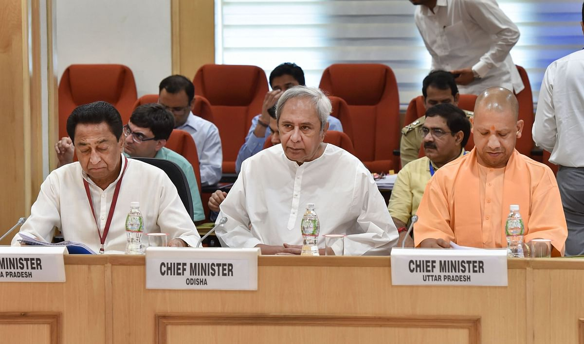 Chief ministers Kamal Nath of Madhya Pradesh, Naveen Patnaik of Odisha and Yogi Adityanath of Uttar Pradesh during Union Home Minister's review meeting on Left Wing Extremism (LWE), at Vigyan Bhavan in New Delhi, Monday, Aug 26, 2019