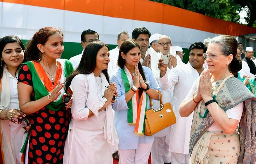 Congress Interim President Sonia Gandhi greets people during the celebration of 73rd Independence Day at AICC Headquarters in New Delhi