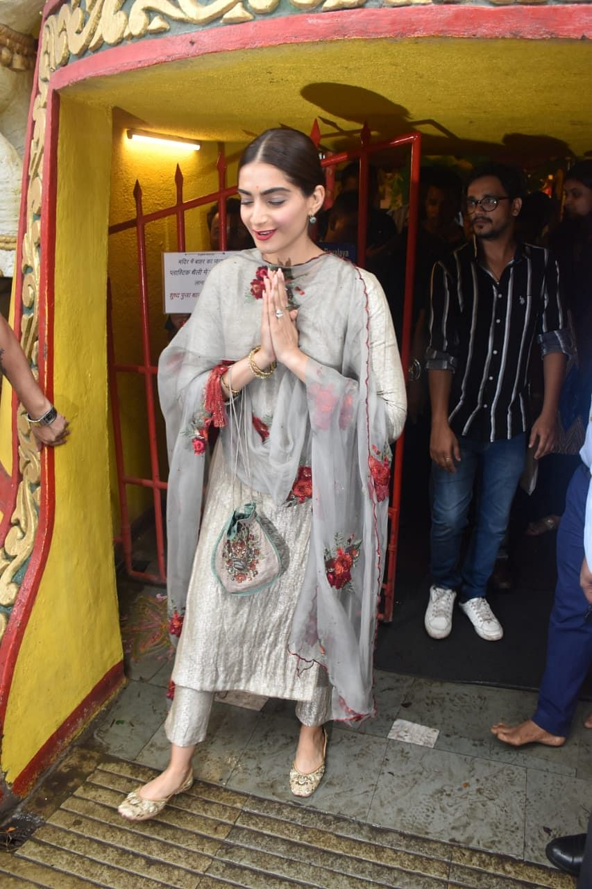 Sonam Kapoor gearing up for the release of 'The Zoya Factor' was snapped at the Shani temple in Juhu wearing a grey salvar suit with red floral design on it.