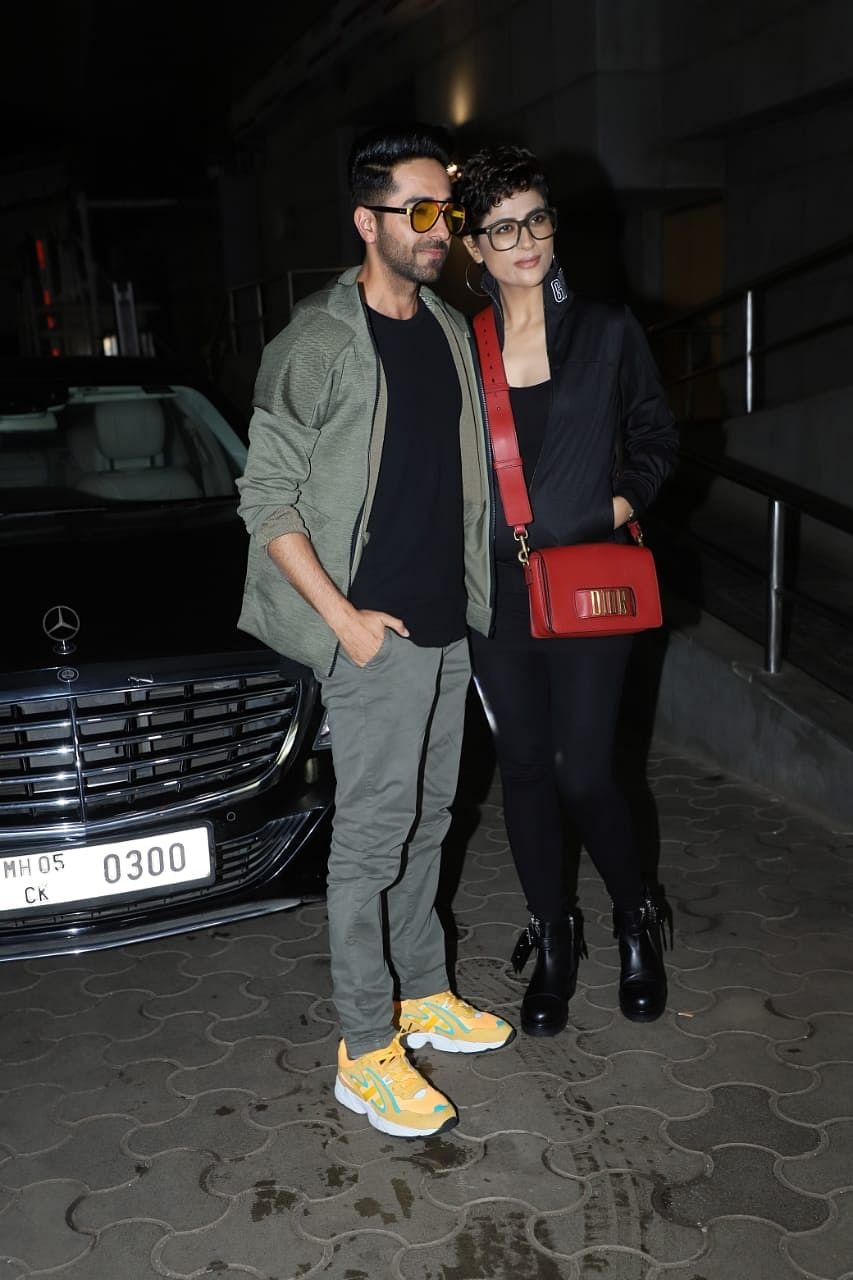 Ayushamann Khurrana was seen wearing green  jacket with matching pants and a black t-shirt twinning with his wife