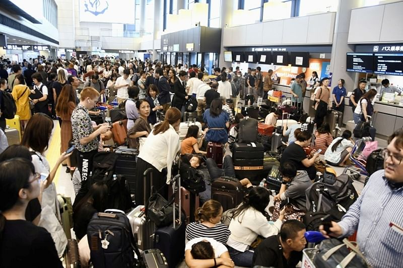Tokyo: 17,000 stranded at airport due to typhoon