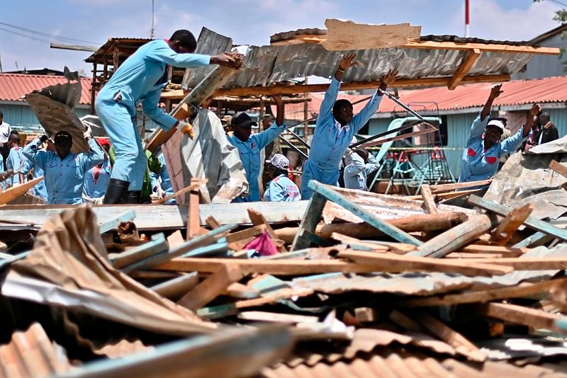 TOPSHOT - Rescuers work to clear debris where a classroom block collapsed at Precious Talents primary school in Nairobi's Dagoretti constituency on September 23, 2019. - Seven children died and scores injured early today when a school building collapsed in the Kenyan capital Nairobi in an accident blamed on shoddy construction. (Photo by TONY KARUMBA / AFP)