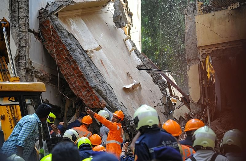 Mumbai: Rescue works underway after a portion of a five-storey building collapsed at Khar (W), Mumbai, Tuesday, Sept. 24, 2019. (PTI Photo) (PTI9_24_2019_000191B)