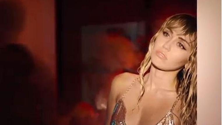 Miley Cyrus goes underwater for 'Slide Away' Music video
