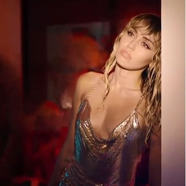 Miley Cyrus goes underwater for 'Slide Away' Music video