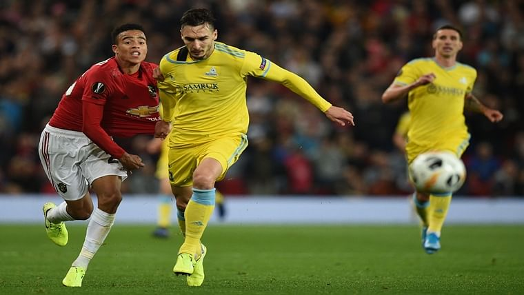 Manchester United's striker Mason Greenwood (L) vies with Astana's Montenegrin defender Zarko Tomasevic during the UEFA Europa League Group L football match between Manchester United and Astana at Old Trafford in Manchester, north west England, on September 19, 2019. - Manchester United won the game 1-0.