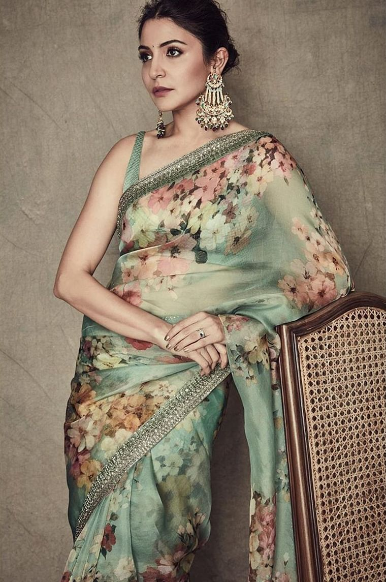 Anushka Sharma is wearing a pastel green floral saree that is one of the suitable greens in trend. Unlike the mundane leafy green, this shade in particular looks royal on couture.