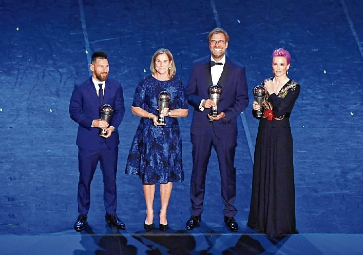 FC Barcelona's Lionel Messi poses after winning the Best FIFA Men's player award with the winner of the Best FIFA Men's coach award Liverpool manager Juergen Klopp, winner of the Best FIFA Women's Player award USA women's Megan Rapinoe and the winner of the Best FIFA Women's coach award USA women's coach Jill Ellis during The Best FIFA Football Awards at Teatro alla Scala in Milan, Italy on Monday.