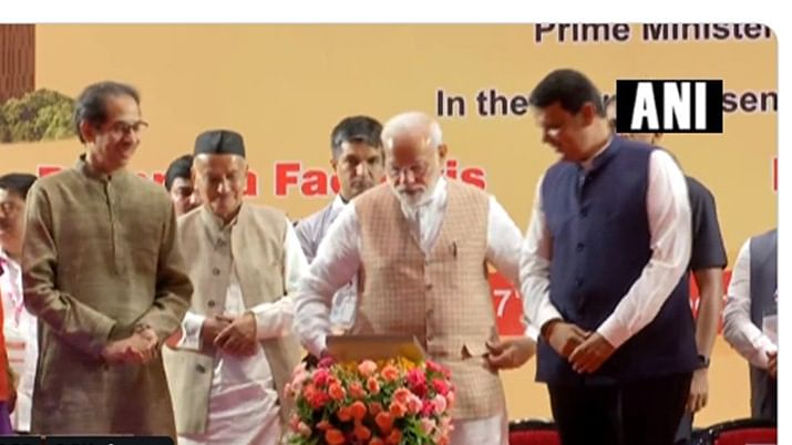 Prime Minister Narendra Modi in brown jacket (C)