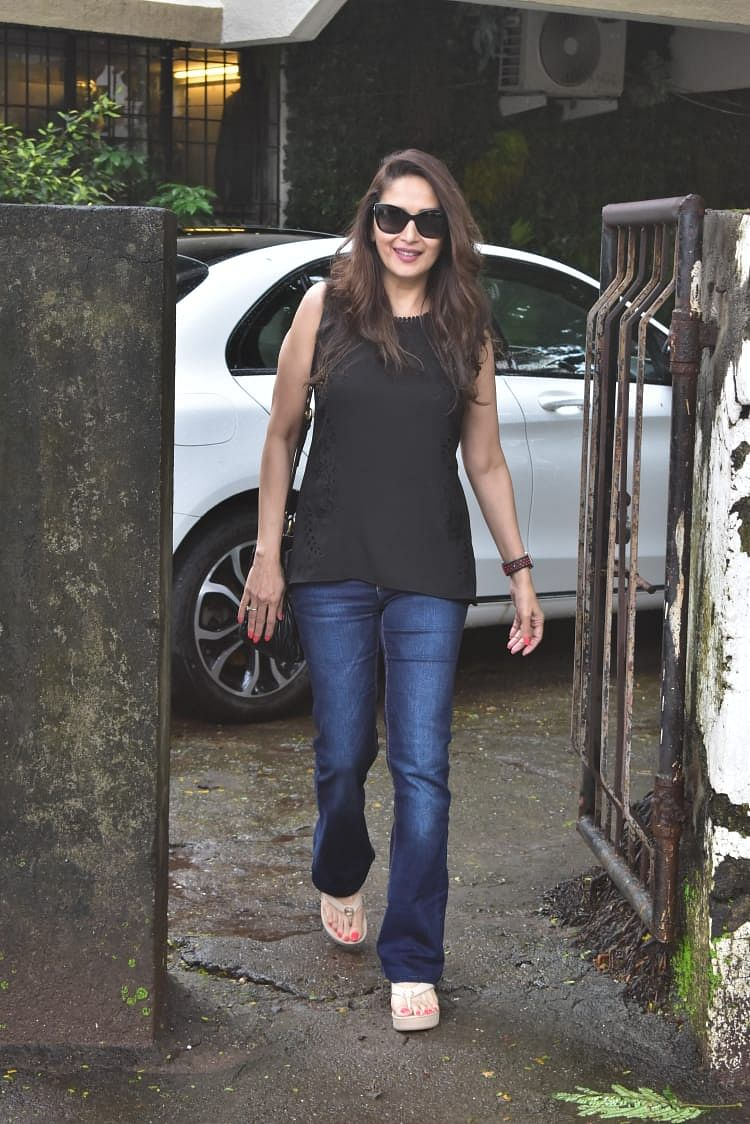 Madhuri Dixit Nene was seen around the city in a casual avatar, wearing a black top and blue jeans.