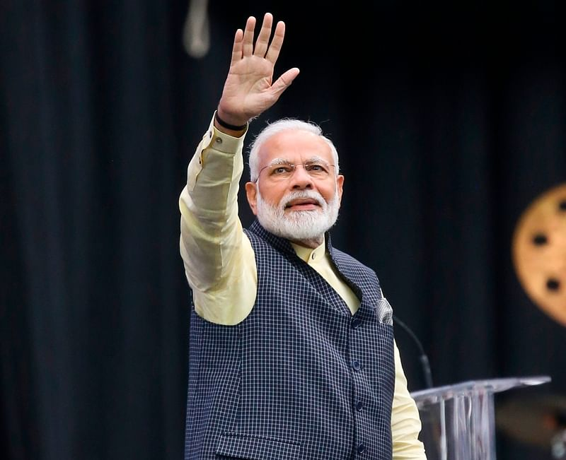 Indian Prime Minister Narendra Modi waves to the audience at the Community Summit on September 22, 2019 at NRG Stadium in Houston, Texas. - Donald Trump and Narendra Modi both rose to power on nationalist appeals to their countries' majority communities. Both scoff at traditional media and enjoy making pronouncements by Twitter. And now, the two leaders will bond over an extravaganza of Indian culture as they visibly symbolize their alliance. The US president will join the Indian prime minister on Sunday at a football stadium in Houston where community representatives say they expect 50,000 Indian-Americans for performances followed by the leaders' remarks. (Photo by Thomas B. Shea / AFP)